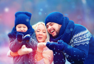 Photo of family catching snowflakes who have found happiness in their relationships