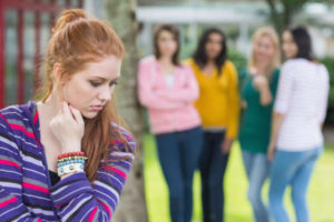 Shy teen feels left out and rejected by peer group. LoriCalabreseMD