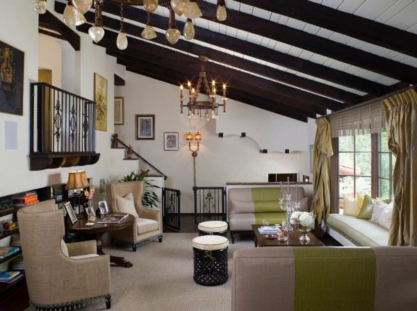 Incorporating Dark Rich Wood Wrought Iron White Plaster Walls And Exposed Beams Creates A Warm Setting Details Like Tassel Trim Cut Crystal Chandeliers