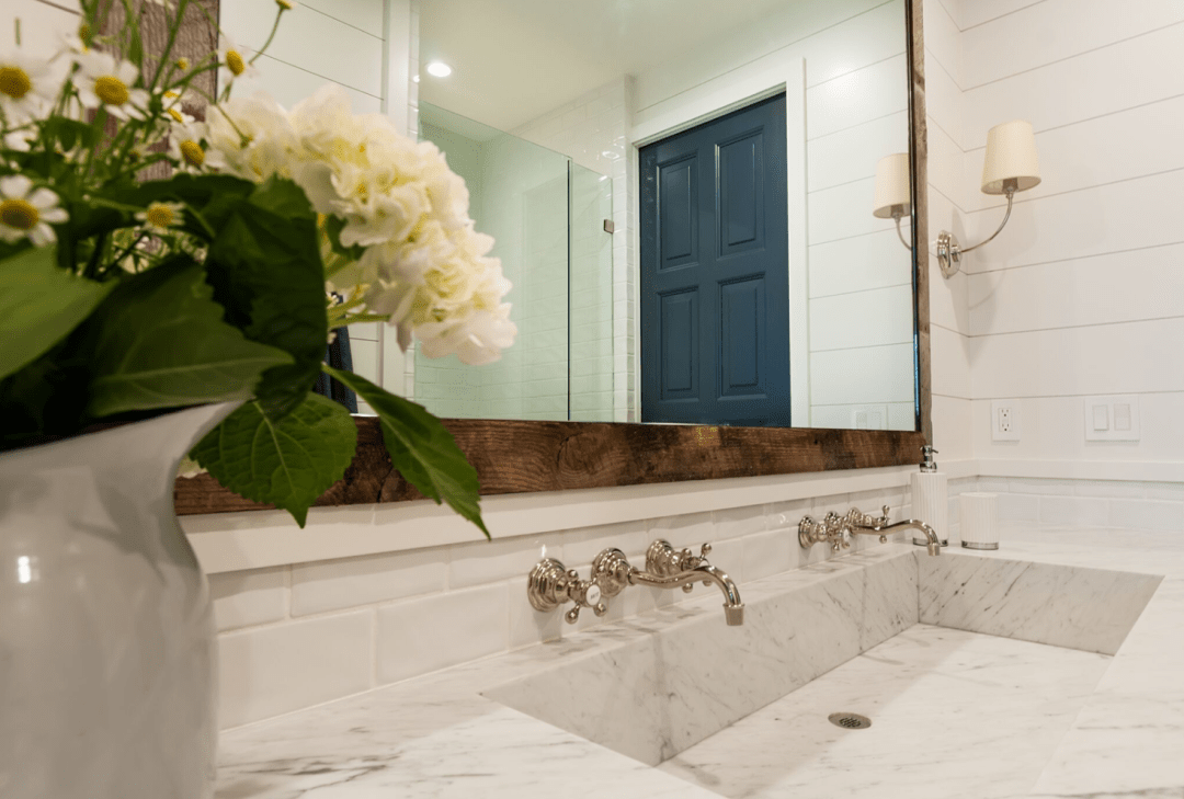 One of the tenets of the modern farmhouse design is including some casual, exposed, industrial features. A great way to introduce this style into your coastal farmhouse bathroom is in the form of an oversized vanity mirror.