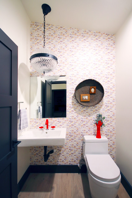 modern powder room with chandelier and red accents designed by Lori Dennis