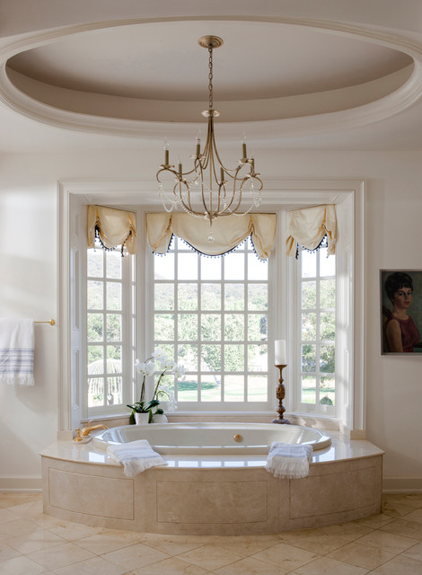 chandelier over bathtub traditional bathroom designed by Lori Dennis
