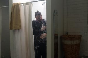 "Alejandro Álvarez Cadilla as Milton Frank, taking a shower in ""Off Kilter."""