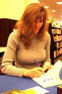 publishing consultant, Lorraine, during a book signing, one of many books written