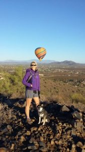 Kuma is rewarded with balloons for hiking Apache Wash. How cool is that?