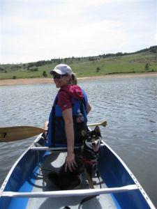 Kuma goes canoeing at Pinewood Lake in Colorado
