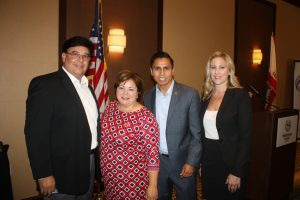Rep. Linda Sanchez joins members of a local real estate association at the Cerritos Regional Chamber of Commerce luncheon last week.  Randy Economy Photo