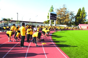Participants in the 3K Fun Run warm up before the event. The race was held at the Fedde Sports Complex which featured a special course designated just for fun. Participants from Hawaiian Elementary School, Furgeson Elementary School and Melbourne Elementary School averaged 28 persons per school.  Artesia High School signed in 60 students. Photo by Tammye McDuff.