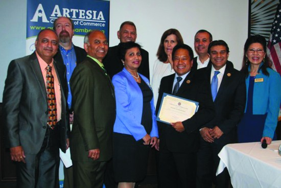 Receiving a Certificate of Appreciation from the Artesia Chamber of Commerce is Mayor Victor Manalo with Chamber member Bipin Morari, City Manager Bill Rawlings, past President Parimal Shah, Member Shaila Patankar, Councilmembers Tony Lima and Sally Flowers, State Senator Tony Mendoza, Mayor Pro-Tem Ali Taj and Chamber President Dr. PaoLing Guo.