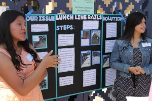 Students Sandra Villanueva, left, and Bethany Vela explain the steps they took to develop and propose a solution that would better control the lunch lines at the Schurr High School cafeteria during the Civic Action Project Showcase at La Plaza de Cultura y Artes.