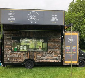 Photo of the Los Churros Amigos food truck at a private event