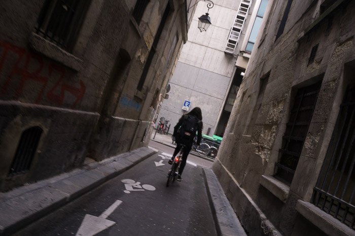 Girl Riding bike down street in Paris France | Lost Not Found | French Road Trip
