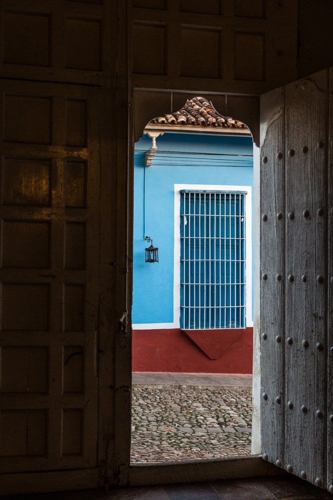 View outside from an old door in Trinidad Cuba | LOST NOT FOUND | Cuba | Trinidad | Street Photography
