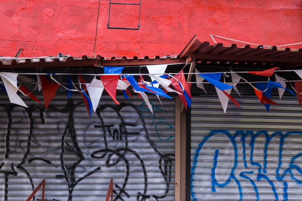 Red awning with red white and blue bunting banner in Brooklyn NYC | LOST NOT FOUND | NYC through a Local's Eyes - A Photo Essay