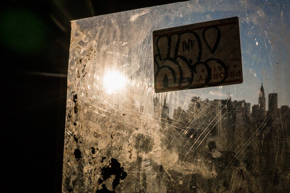View of the Empire State Building through dirty plastic on a construction site in Brooklyn | LOST NOT FOUND | NYC through a Local's Eyes - A Photo Essay