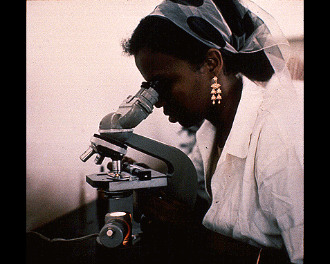100 - Woman with microscope, UN