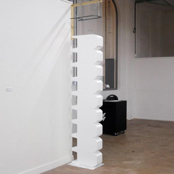 Teun Welten - A lote like advertisement - RVS, sticker met marmermotief, EPS blokken, hangend stalen frame met contourvorm