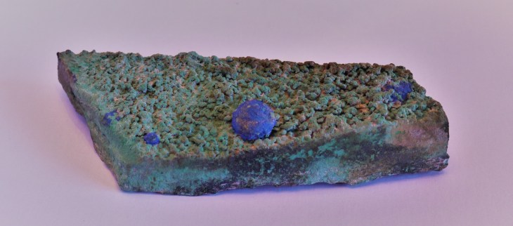 Azurite ball on a bed of Malachite from the Nacimiento mine.