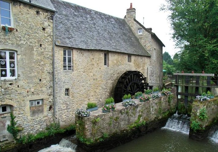 French watermill diverting river. On the right a weir and a lock used to regulate water influx.