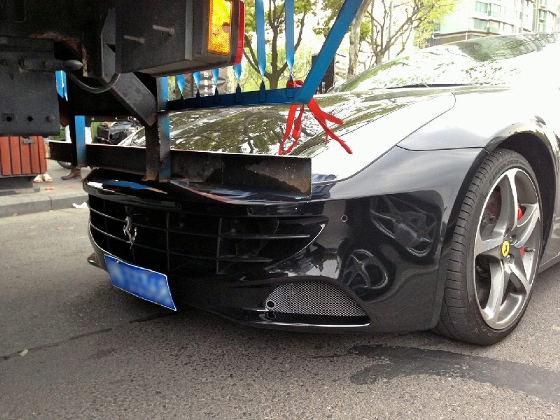 Ferrari accident in Shanghai bike lane. Photo by Chiprdan.