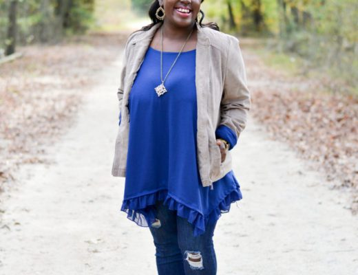 moto jacket ripped jeans taupe booties ruffle top gold earrings