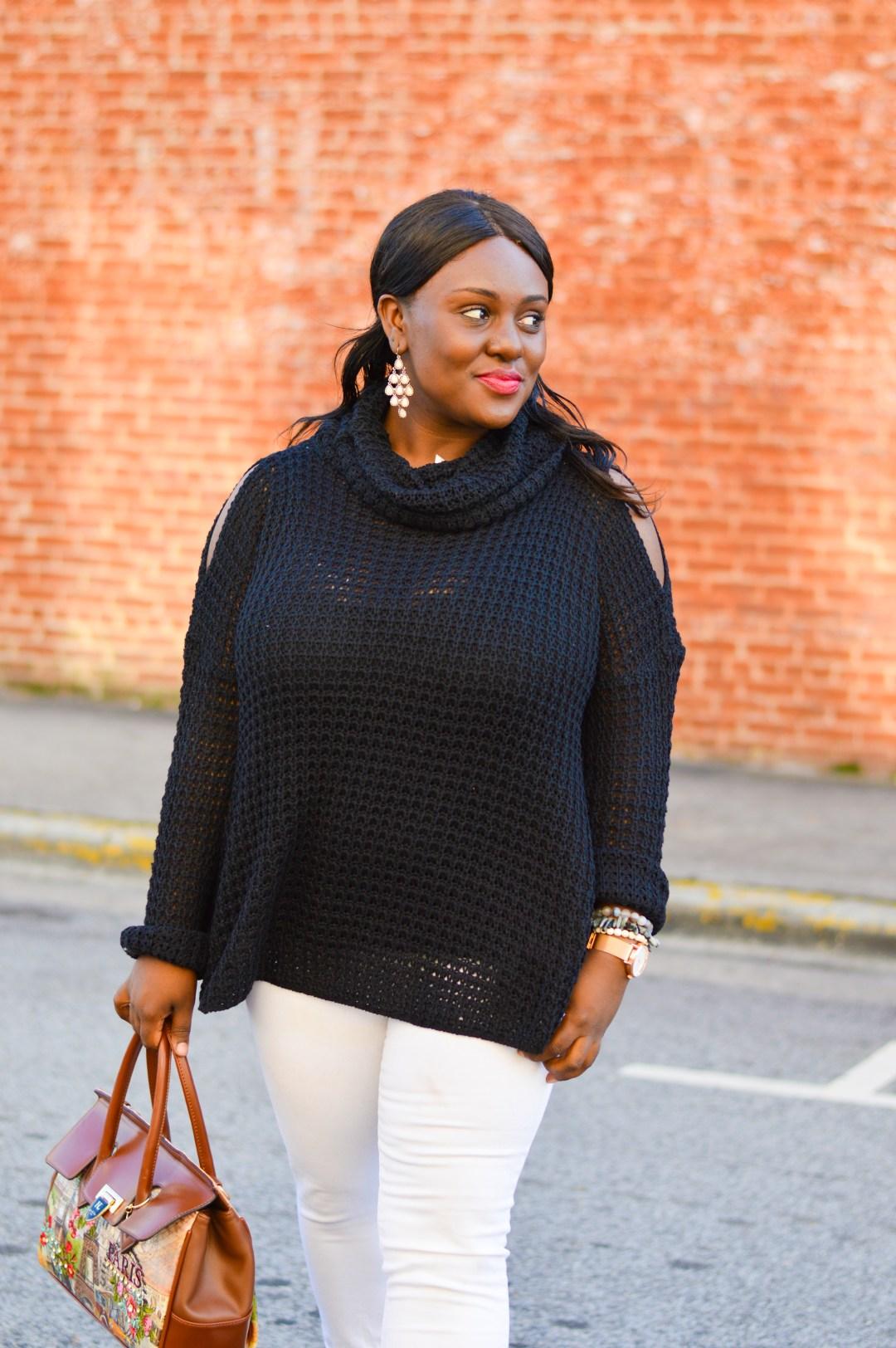 black cowl neck cold shoulder sweater white jeans tommy hilfiger black mules printed paris bag gold accessories