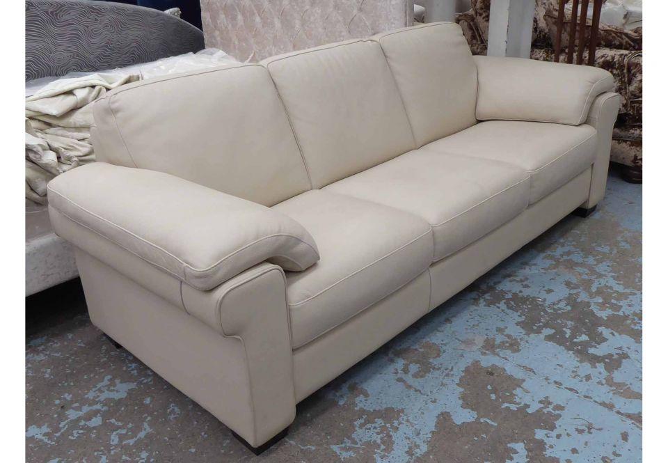 There is full grain and top grain lea. NATUZZI SOFA, three seater, cream leather, 230cm W x 92cm D.