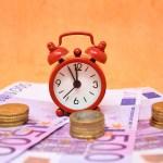 Geld Zeit Symbolbild