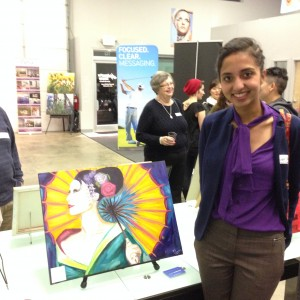 Juhee Jain stands next to her oil painting of a geisha.