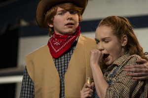 """UNITED STATES - November 30, 2015: Brody Brown playing Curly and Shannon Connors, who plays Laurey in Loudoun County High School Drama & Choral Department's dress rehearsal of Rodgers & Hammerstein's """"Oklahoma"""". The Play opens on December 3rd and runs for three nights. (Photo by Douglas Graham/Loudoun Now)"""