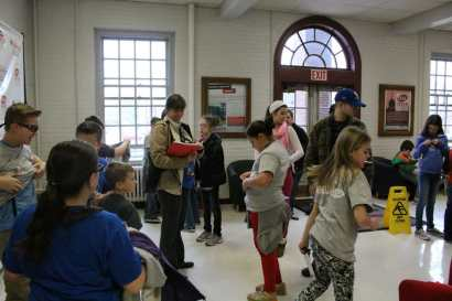Kids observe demonstrations in the civil engineering lab.