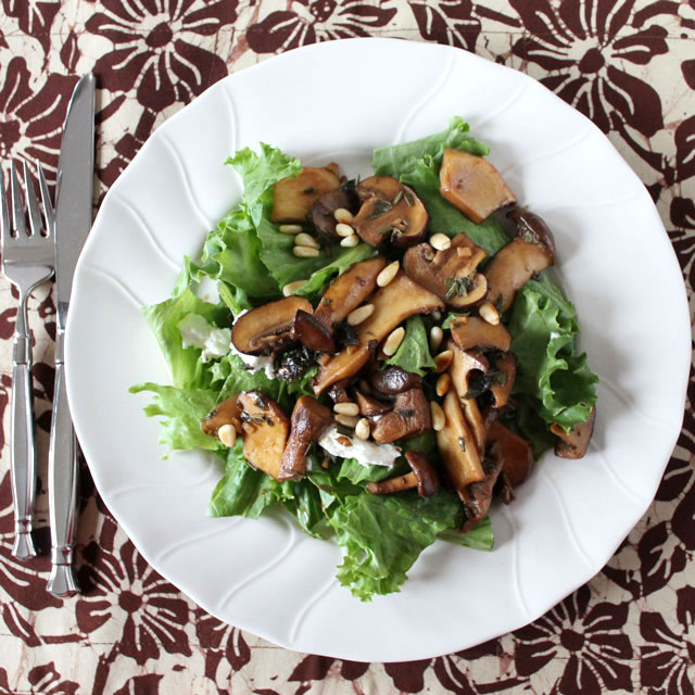 salad-with-mushrooms-goat-cheese-and-pinenuts-served-warm