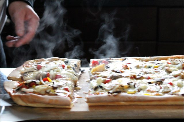 serving-homemade-pizza