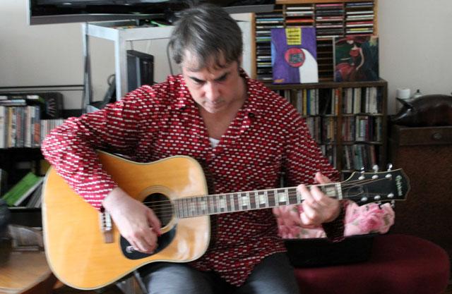 nick-playing-guitar