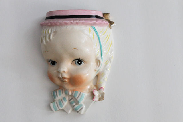 thrifted wall pocket vintage girl head
