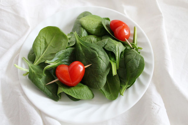 salad with heart tomatoes Valentine meal