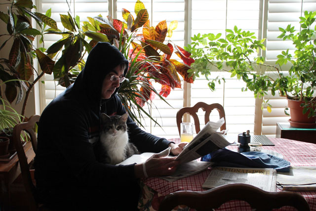 man-and-cat-reading-paper-03