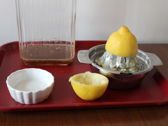 making-hot-tea-cocktail-with-lemon-and-brown-sugar