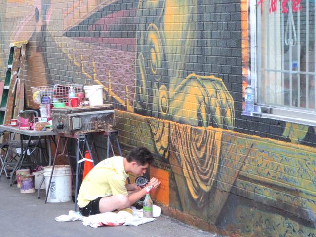final-touches-on-mural-dundas-street-toronto