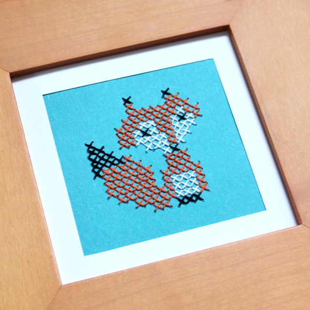 close-up-cross-stitched-fox-on-paper