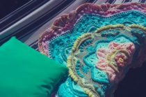Mandala madness by Helen Shrimpton resting on stripy hammock