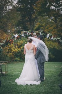 wind blowing a wedding veil during the ceremony