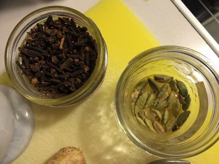 Cloves left, cardamom pods right