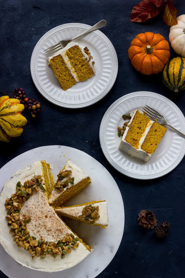 GF pumpkin layer cake with cream cheese frosting on plates