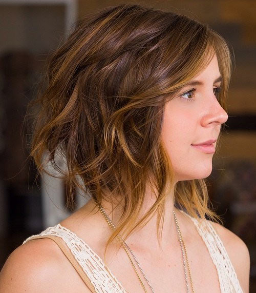 Super-trendy long bob with edgy disconnected layers & yellow highlights
