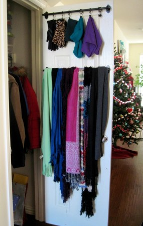 Organize hats, gloves and scarfs with rails and drapery rings on the inside of your door.