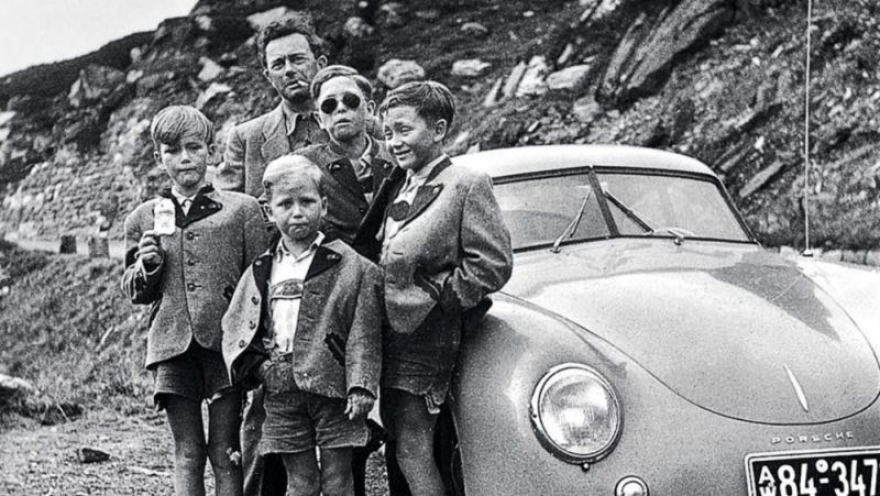 Wolfgang Porsche (front) in 1950 at the age of seven with his father, Ferry, and brothers Hans-Peter (left), Gerhard (right), and Ferdinand Alexander (in sunglasses), and a Porsche 356 Coupé.