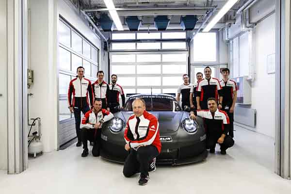 Marco Ujhasi and his team in front of the 2017 GTE/GTLM Porsche