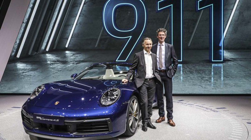 Geneva International Motor Show 2019: the outgoing and the future Vice President Product Line 911/718, August Achleitner (left) and Frank-Steffen Walliser, at the presentation of the new 911 Carrera Cabriolet