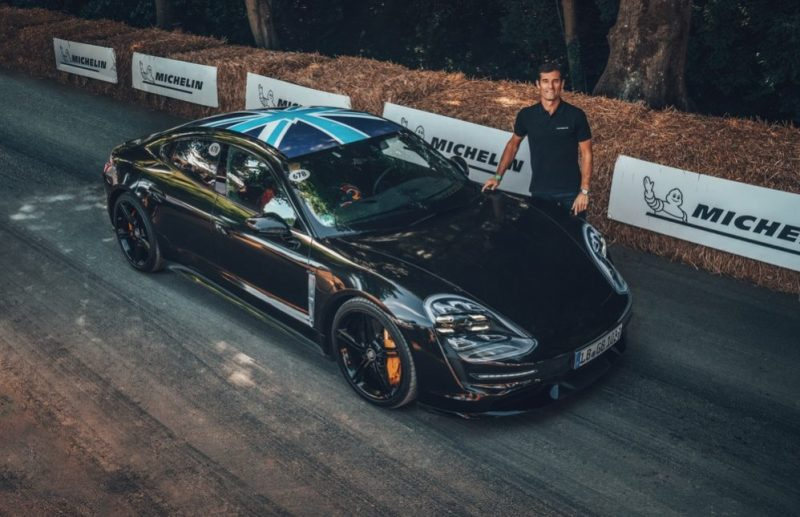 Mark Webber drives the Porsche Taycan at the Goodwood Festival of Speed